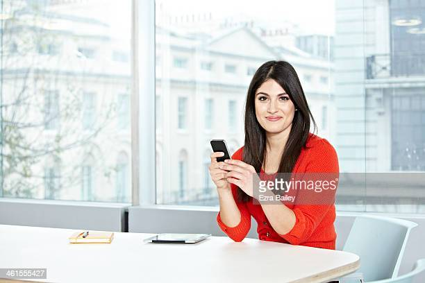 Portrait of a business woman with mobile phone.