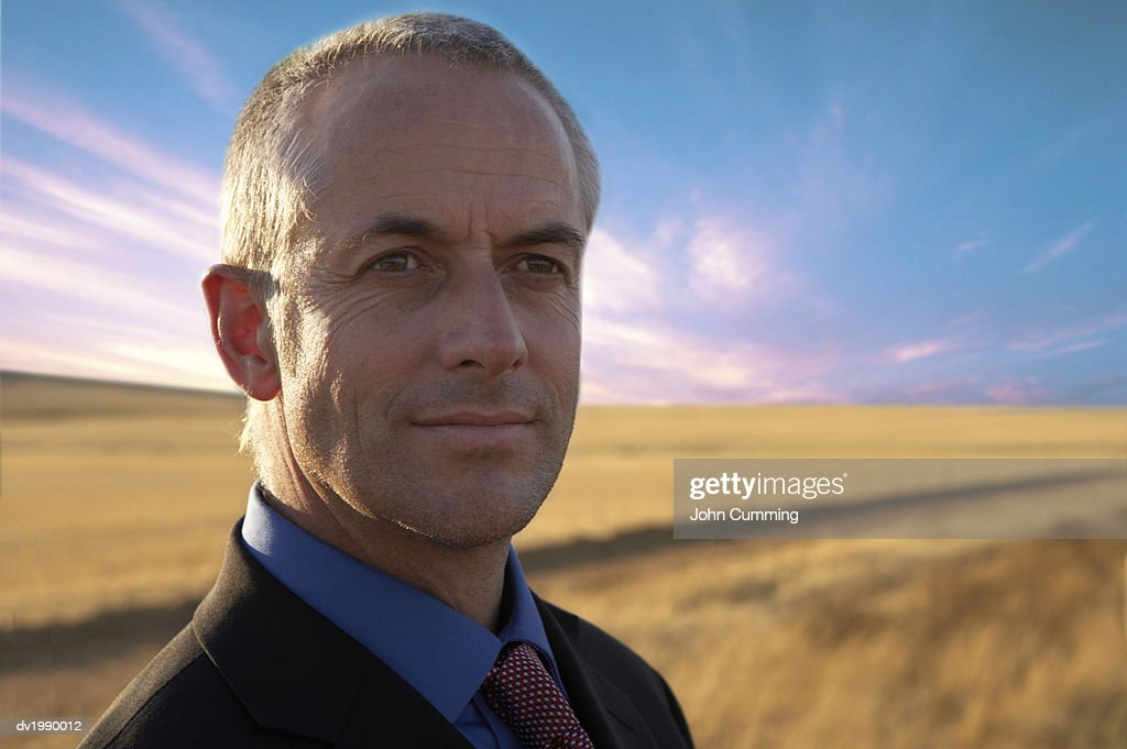 Portrait of a Businessman Against a Field of Grass : Stock Photo