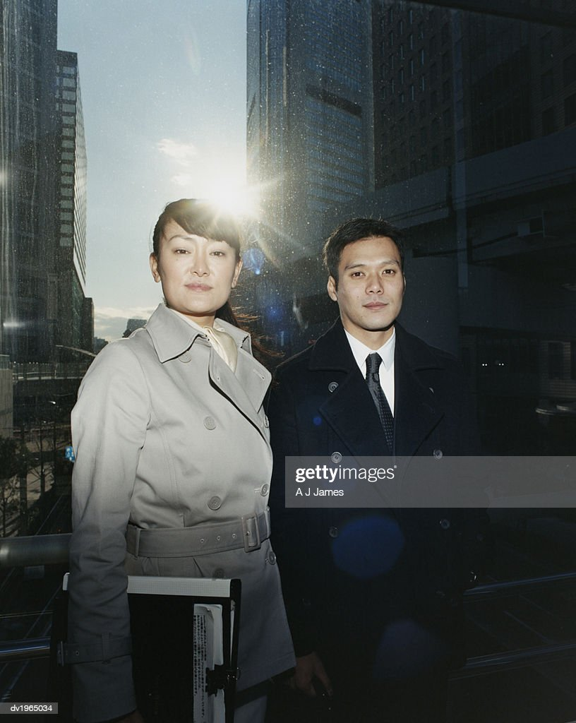 Portrait of a Businessman and Businesswoman Standing on a Footbridge, Lens Flare From the Sun : Stock Photo