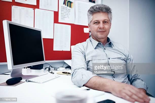 Portrait of a businessman at his desk