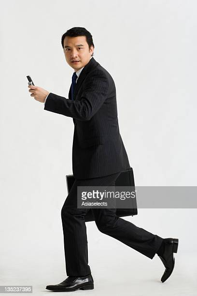 Portrait of a businessman carrying a briefcase