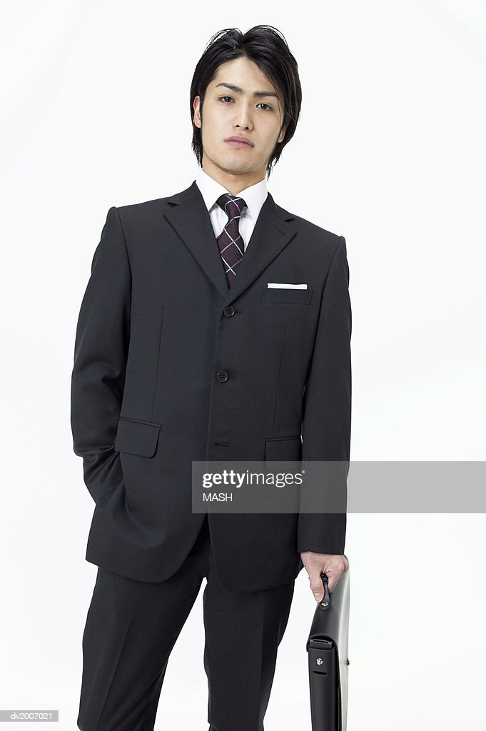 Portrait of a Businessman Carrying a Briefcase : Stock Photo