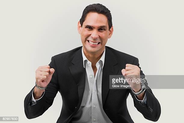 Portrait of a businessman cheering