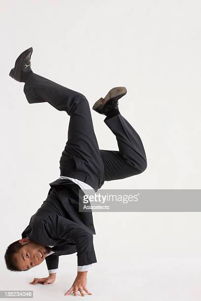 Portrait of a businessman doing a handstand