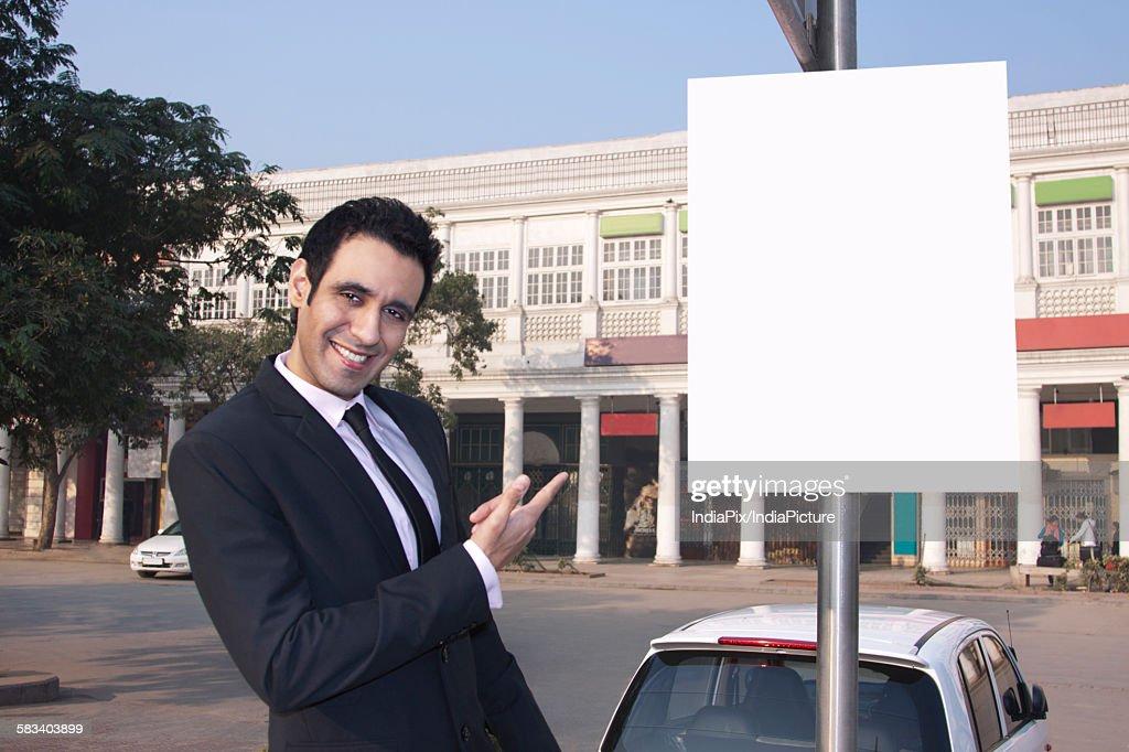 Portrait of a businessman gesturing , INDIA , DELHI : Stock Photo