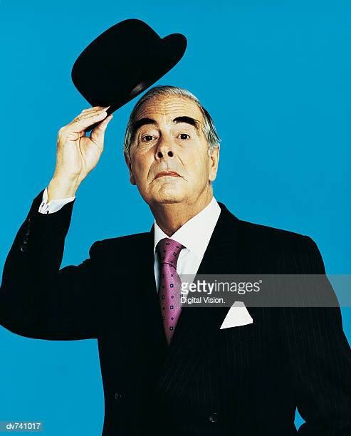 Portrait of a Businessman Holding a Bowler Hat