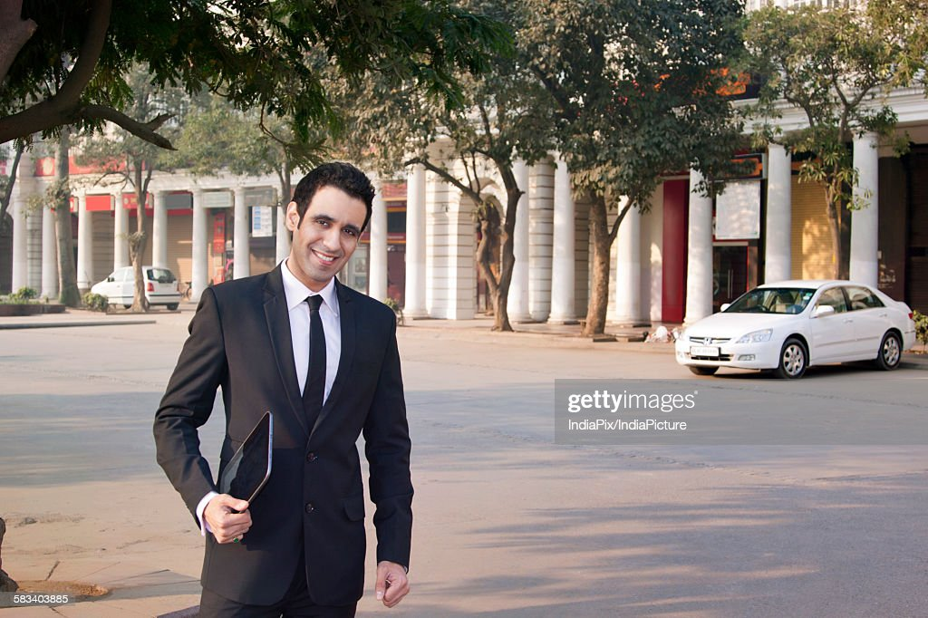 Portrait of a businessman holding a digital tablet , INDIA , DELHI : Stock Photo