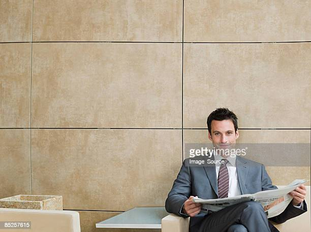 Portrait of a businessman holding a newspaper