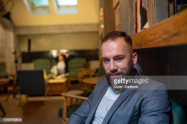 portrait of a businessman in a cafe - dusan stankovic stock pictures, royalty-free photos & images