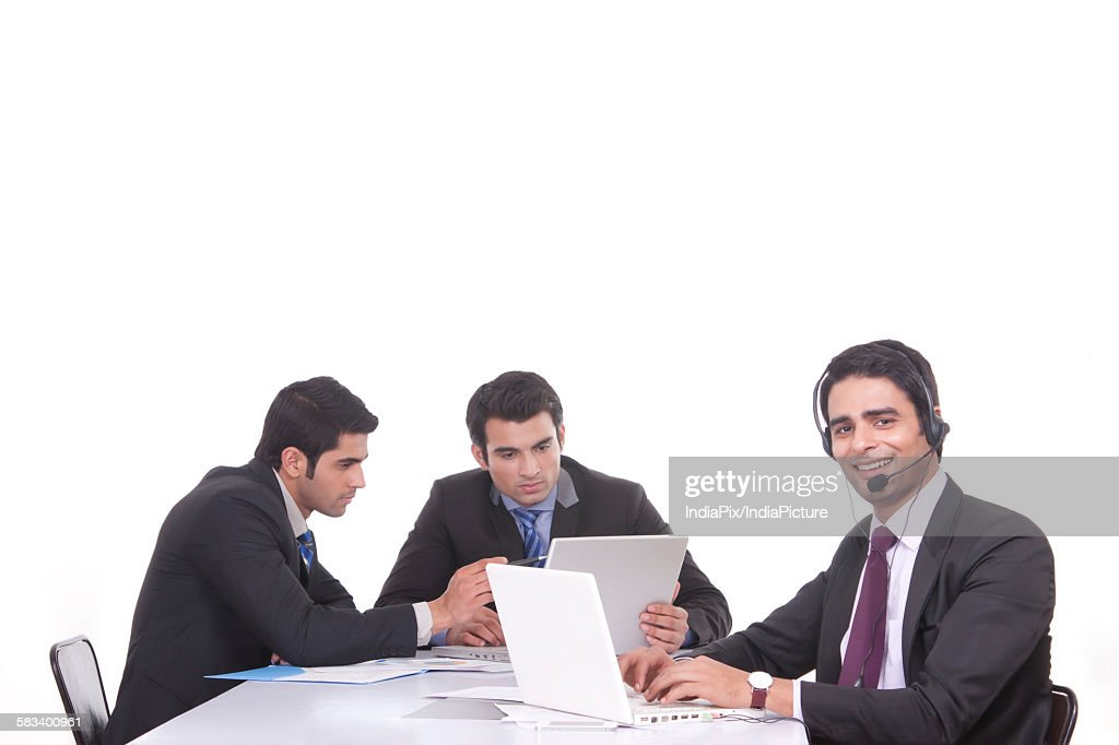 Portrait of a businessman in a meeting : Stock Photo