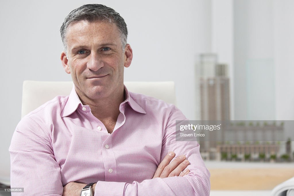 Portrait of a businessman in architects office : Stock Photo