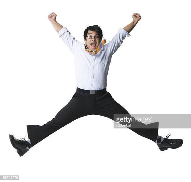 portrait of a businessman jumping in midair - legs apart stock pictures, royalty-free photos & images