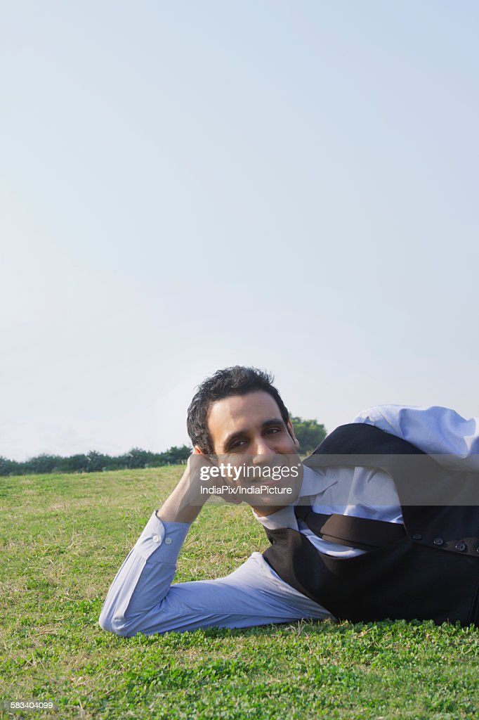 Portrait of a businessman lying down , INDIA , DELHI : Stock Photo