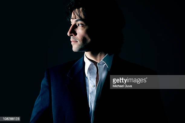 portrait of a businessman on a black background - オープンネック ストックフォトと画像
