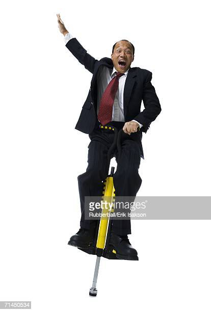 Portrait of a businessman on a pogo stick