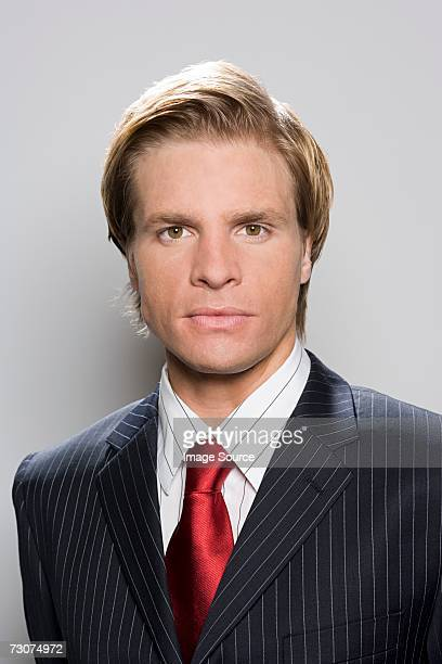 portrait of a businessman - striped suit stock photos and pictures