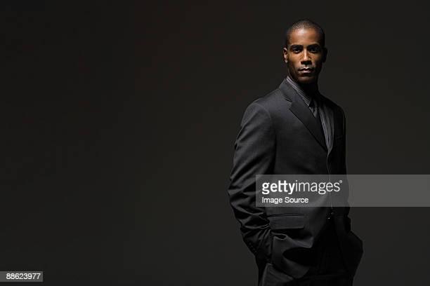 portrait of a businessman - black suit stock pictures, royalty-free photos & images