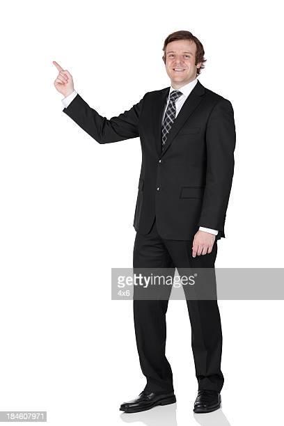 ビジネスマンの指を指すのポートレート - 人差し指 ストックフォトと画像