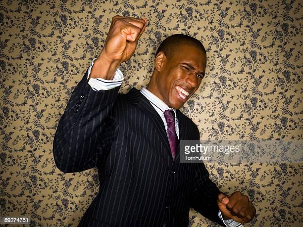 Portrait of a businessman, pumping his fist