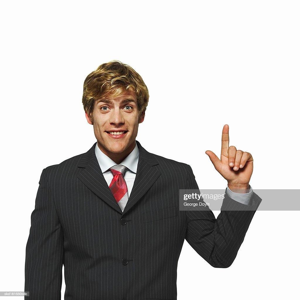 portrait of a businessman raising a finger : Stock Photo