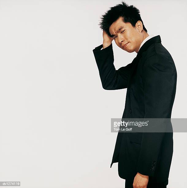 Portrait of a Businessman Scratching His Head
