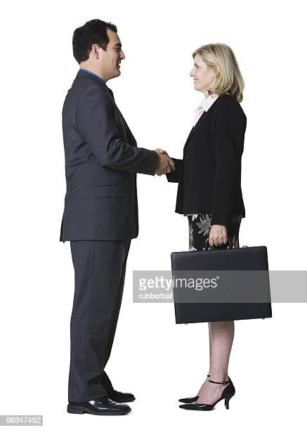 Portrait of a businessman shaking hands with a businesswoman