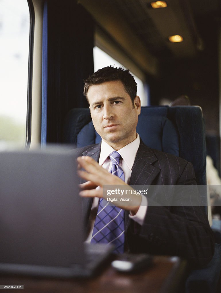 Portrait of a Businessman Sitting on a Seat on a Passenger Train : Stock Photo