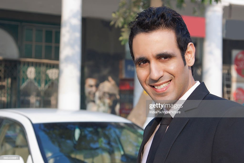 Portrait of a businessman smiling , INDIA , DELHI : Stock Photo
