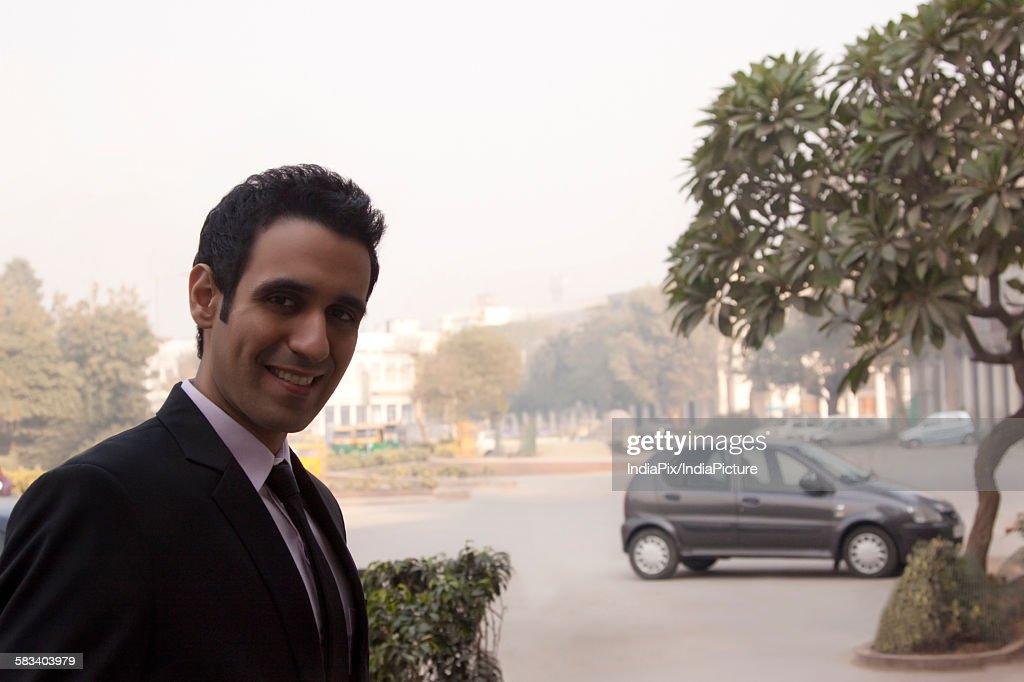 Portrait of a businessman smiling , INDIA , DELHI : Stock Photo