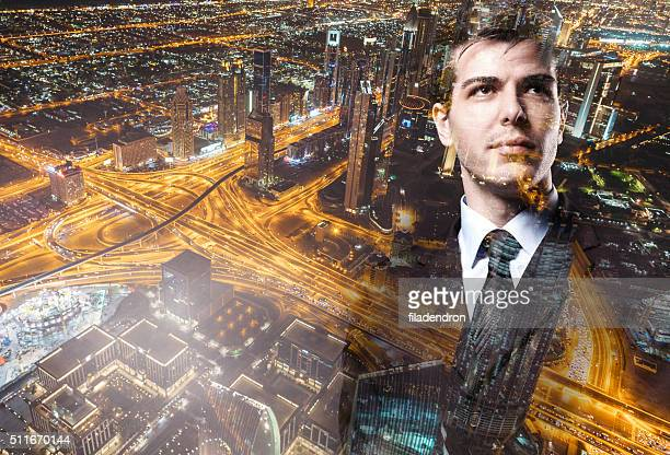 Portrait of a businessman superimposed over a cityscape