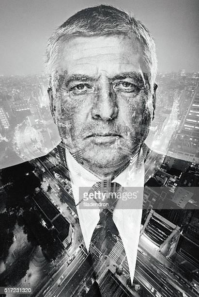 Portrait of a businessman superimposed over a cityscape
