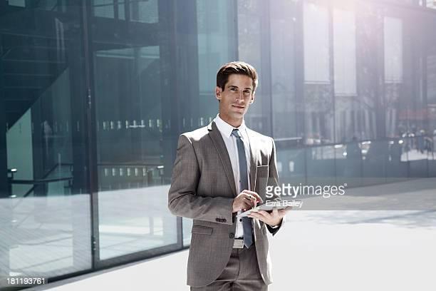 Portrait of a businessman using a tablet.