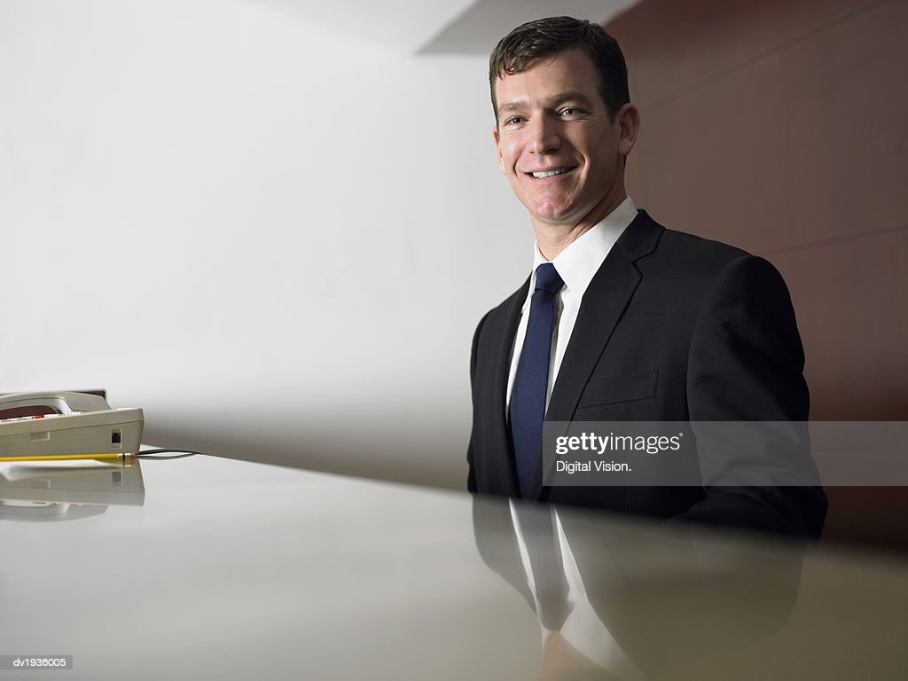Portrait of a Businessman Waiting at a Reception Desk : Stock Photo