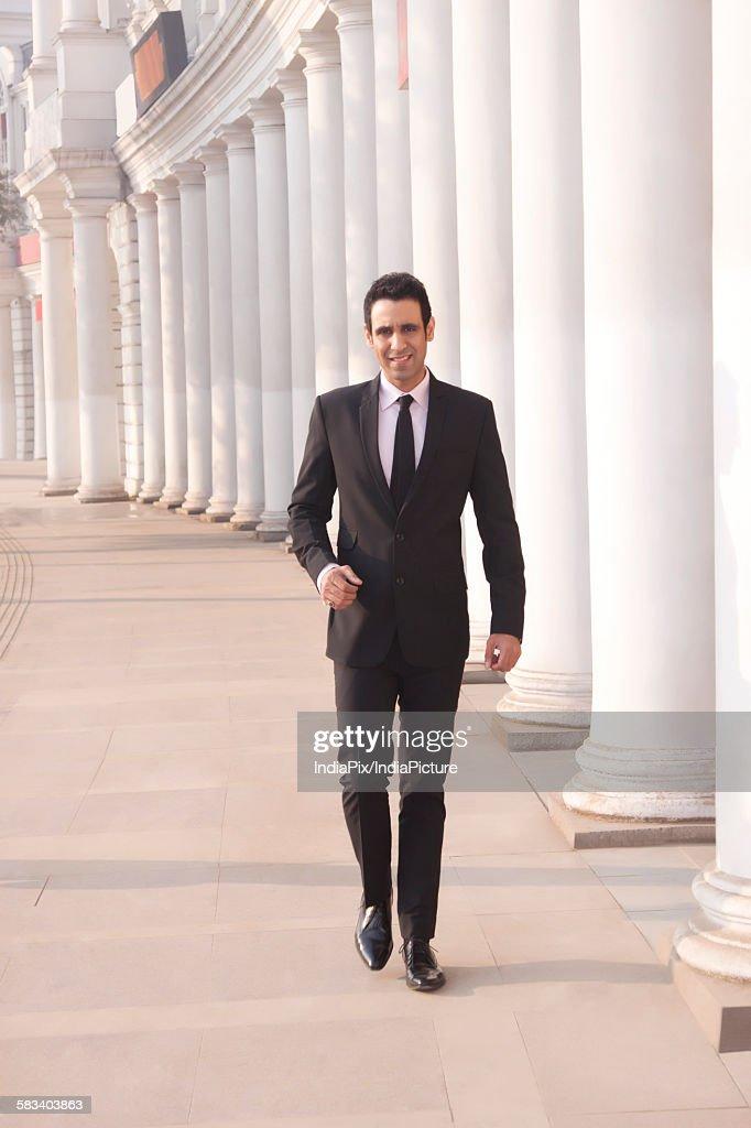 Portrait of a businessman walking  , INDIA , DELHI : Stock Photo