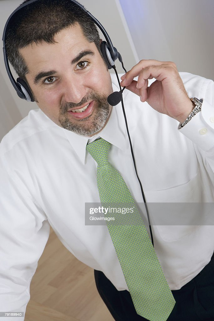 Portrait of a businessman wearing a headset : Stock Photo