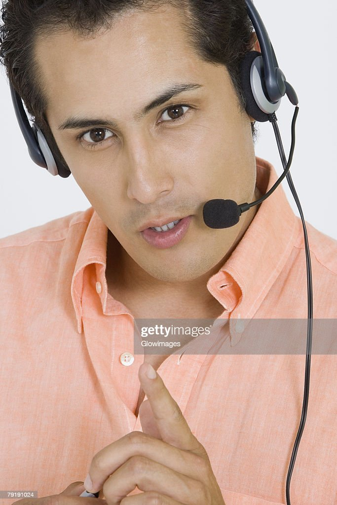 Portrait of a businessman wearing a headset : Foto de stock