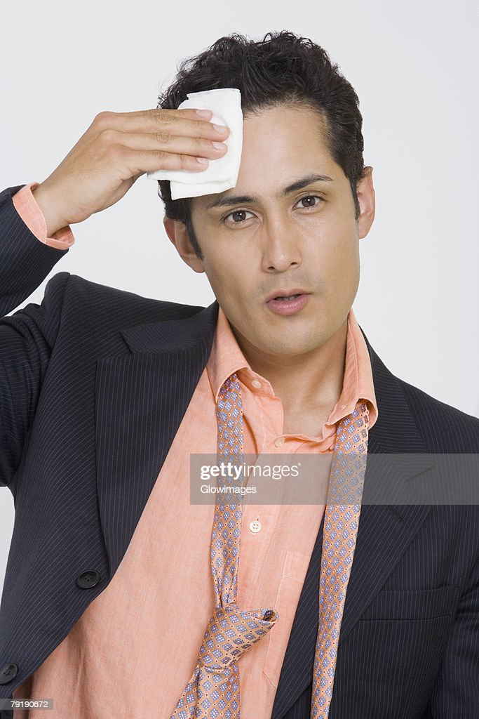 Portrait of a businessman wiping sweat with a handkerchief : Foto de stock