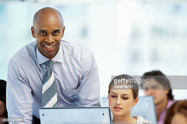 portrait of a businessman with four business executives in an office