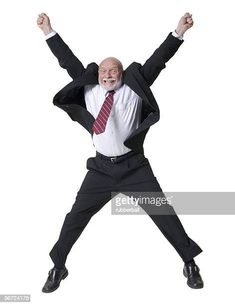 Portrait of a businessman with his arms raised