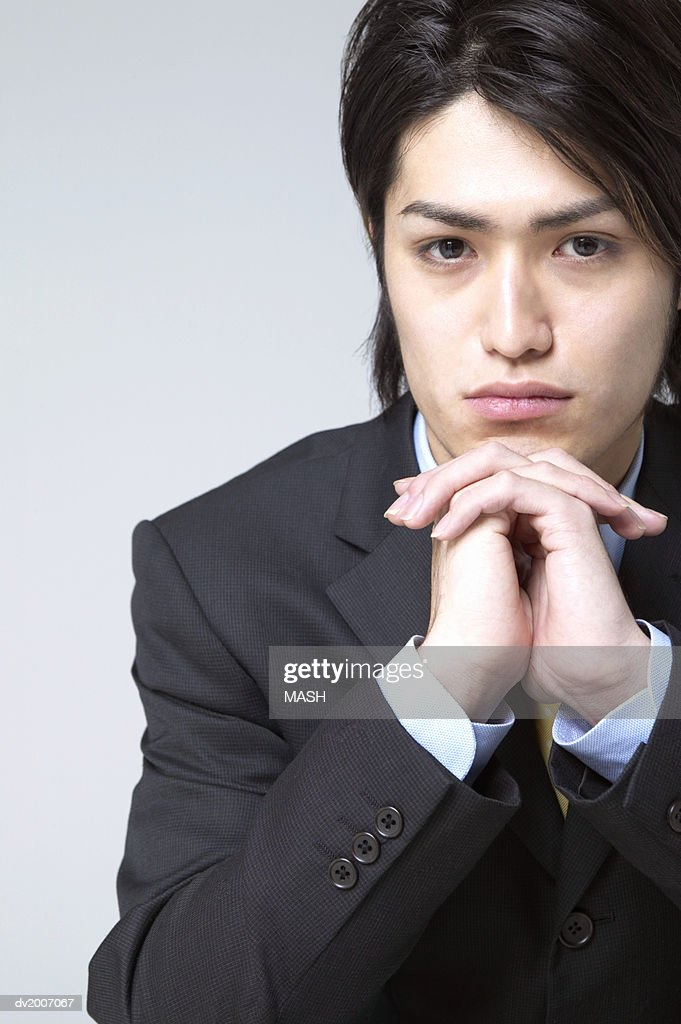 Portrait of a Businessman With His Hands on His Chin : Stock Photo