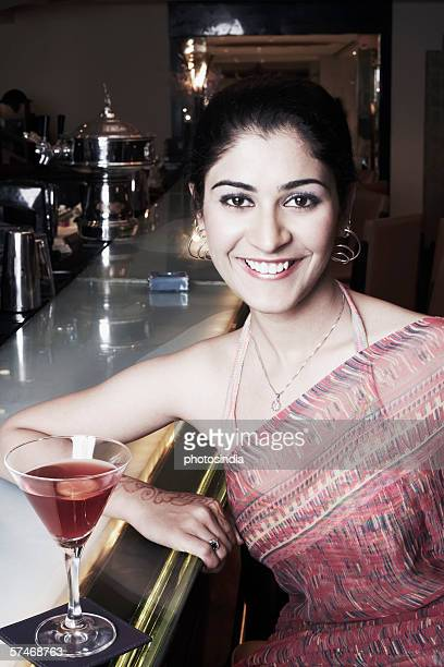 Portrait of a businesswoman at a bar counter with a martini glass