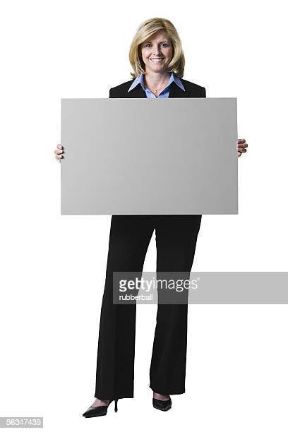 Portrait of a businesswoman holding a blank sign