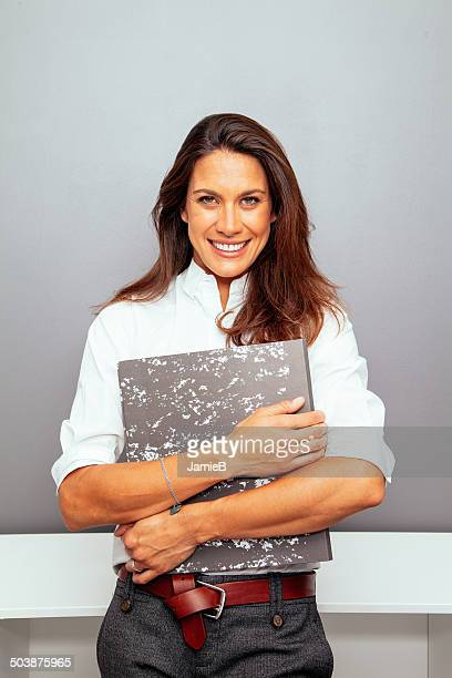 Portrait of a Businesswoman holding a folder