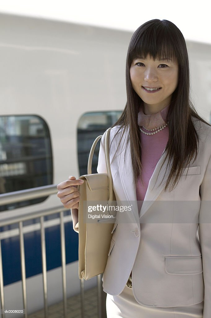 Portrait of a Businesswoman Holding a Shoulder Bag : Stock Photo