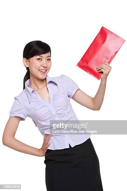 Portrait of a Businesswoman Holding Chinese New Year Envelopes