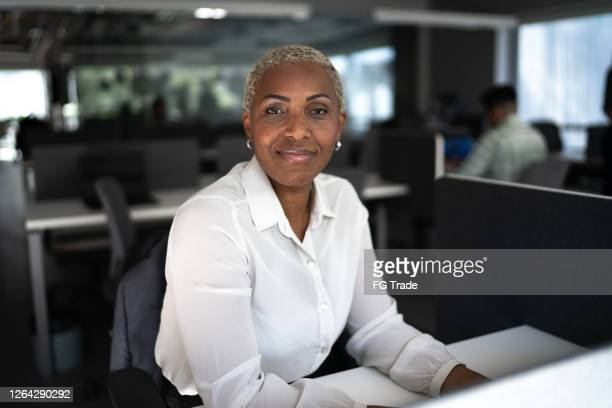 portrait of a businesswoman in the office - african american ethnicity stock pictures, royalty-free photos & images