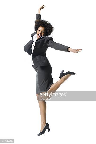 portrait of a businesswoman jumping - black skirt stock pictures, royalty-free photos & images