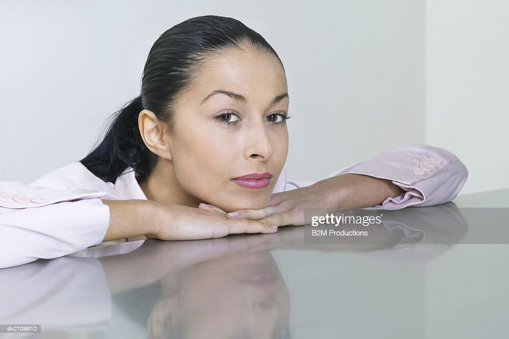 Portrait of a Businesswoman Leaning on a Desk : Stock Photo