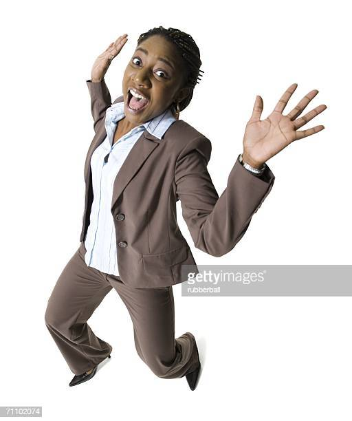 Portrait of a businesswoman making a face with her arms raised