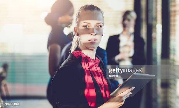 Portrait of a Businesswoman on a Meeting Holding a Tablet